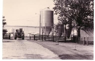 b & w tractor on farm